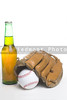 A baseball, mitt and a bottle of beer.