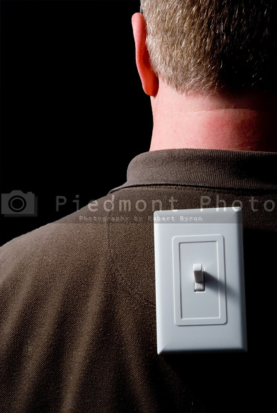 A man with a light switch on his back.