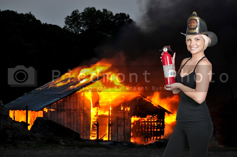 A beautiful woman firefighter at a fire