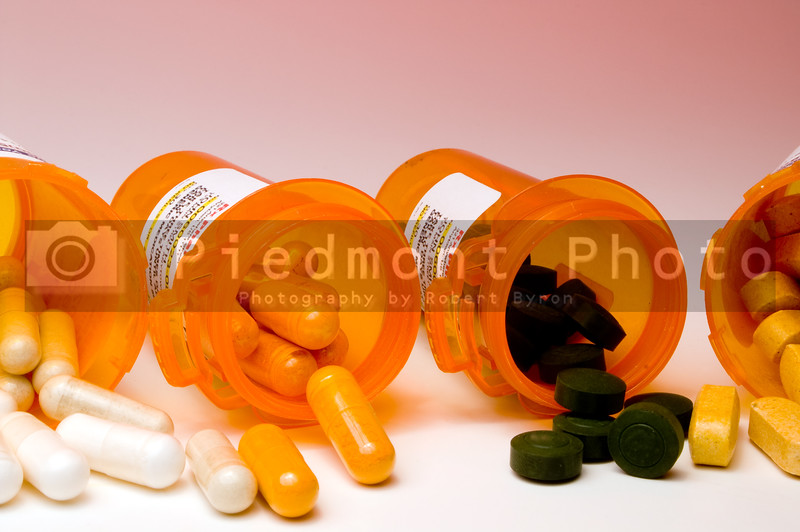 Prescription pills in a plastic medicine bottle.