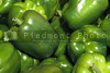 A pile of fresh and delicious green bell peppers.