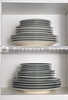 Stacks of plates in a kitchen cabinet.