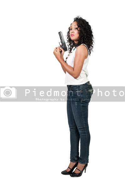 A beautiful black African American police detective woman on the job with a gun
