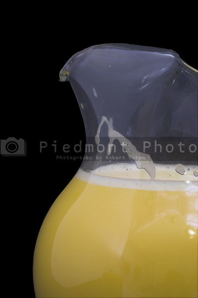Freshly squeezed orange juice in a pitcher.