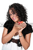 A beautiful African American woman holding an apple