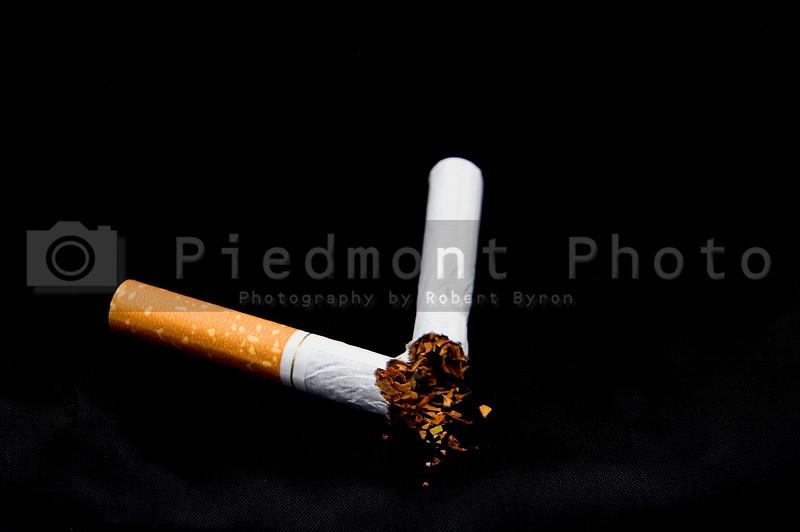 A broken nicotine laden tobacco cigarette.