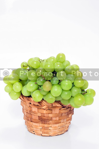 A basket full of fresh grapes.