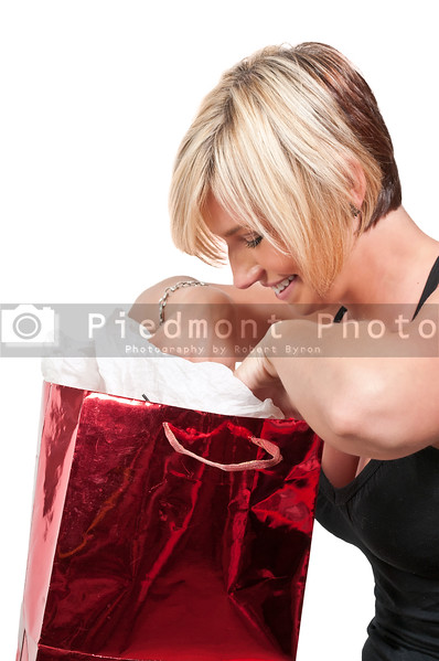 A beautiful woman holding a Christmas gift present bag