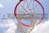 A basketball goal wating for a game to start.
