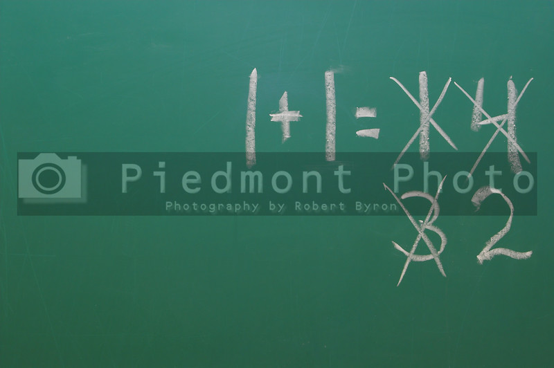 A chalkboard with the equation 1 1=2.