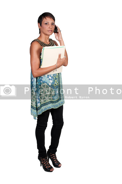 A beautiful business woman holding manilla file folders while talking on a phone