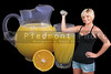 A healthy woman lifting weights in front of orange juice