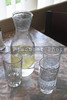 A set of water glasses on a restaurant table.