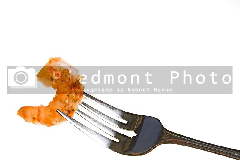 A fork full of delicious gourmet garlic shrimp..