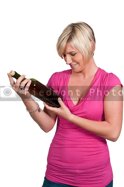 A beautiful woman holding a bottle of wine