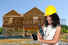Black woman African American constuction worker holding a cordless drill