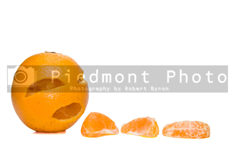 An orange waiting to be peeled and eaten.