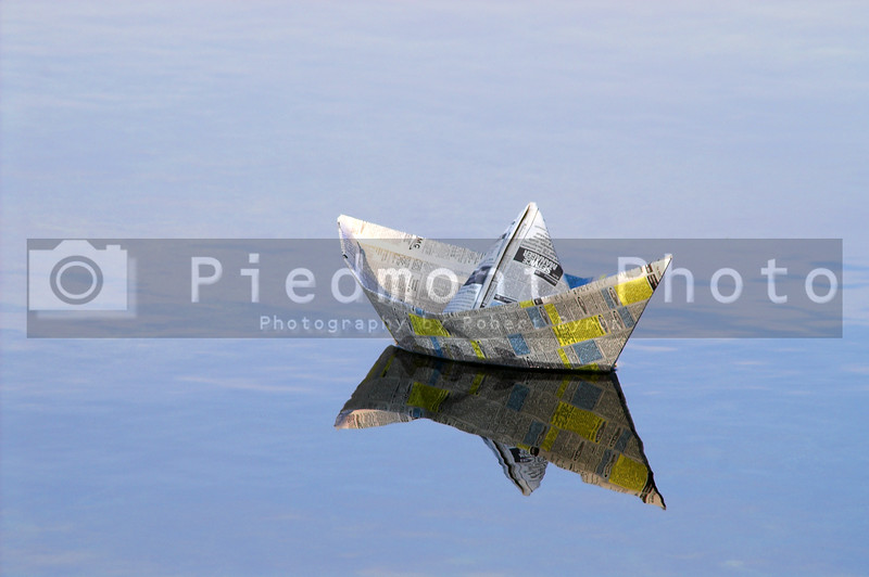 A paper boat sailing on the high seas.