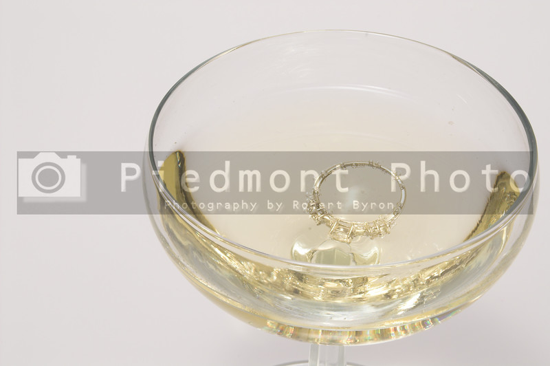 An engagement ring in a glass of champagne.