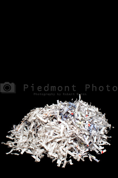 Destroyed documents in a pile from a paper shredder.