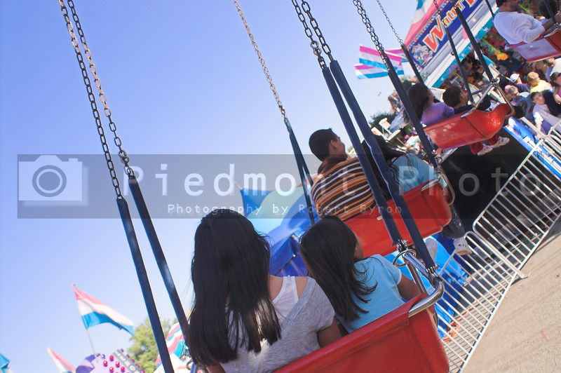 A kiddie swing ride at a carnival.