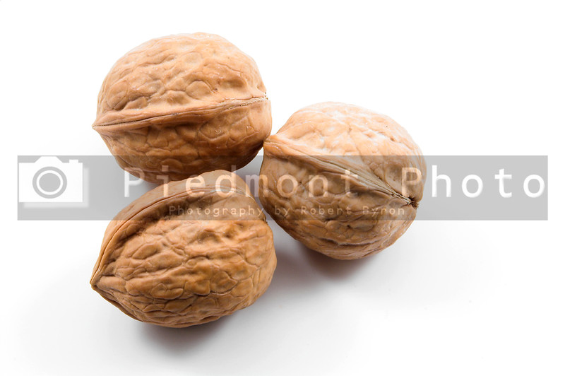 Delicious whole uinshelled walnuts ready for consumption.