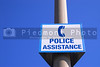A police assistance sign in a public area.