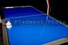 An air hockey table in an arcade.