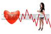 A beautiful African American woman holding an apple standing next to a heart shaped apple electrocardiogram