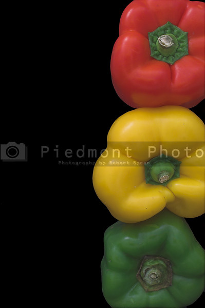 Several fresh and delicious stoplight bell peppers.