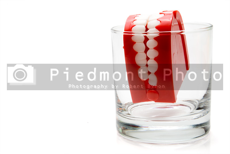 A set of chattering teeth in a glass.