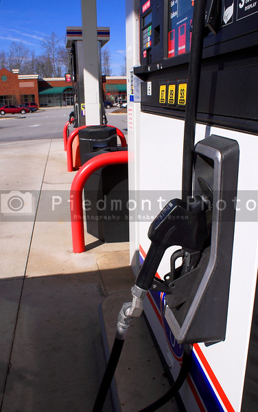 A line of gas pumps at a srvice station.