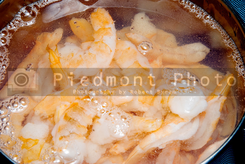A boiling pot of delicious seafood known as shrimp.