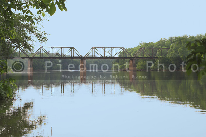 An old vintage train trestle over a river.