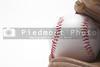 A baseball inside of a baseball glove.