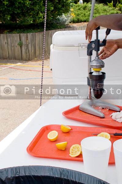 A woman preparing fresh lemonade with a juicer.
