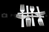 A collection of plastic forks in a pattern.