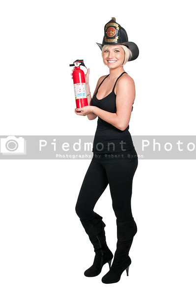 A beautiful woman firefighter with a fire extiguisher