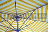 An opened beach, pool or patio umbrella.
