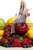 Beautiful woman sitting with a delicious assortment of fruit