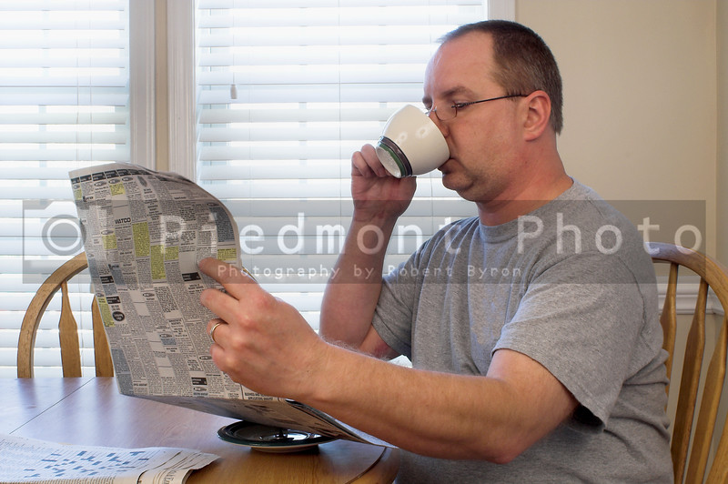A man drinking his morning coffee.