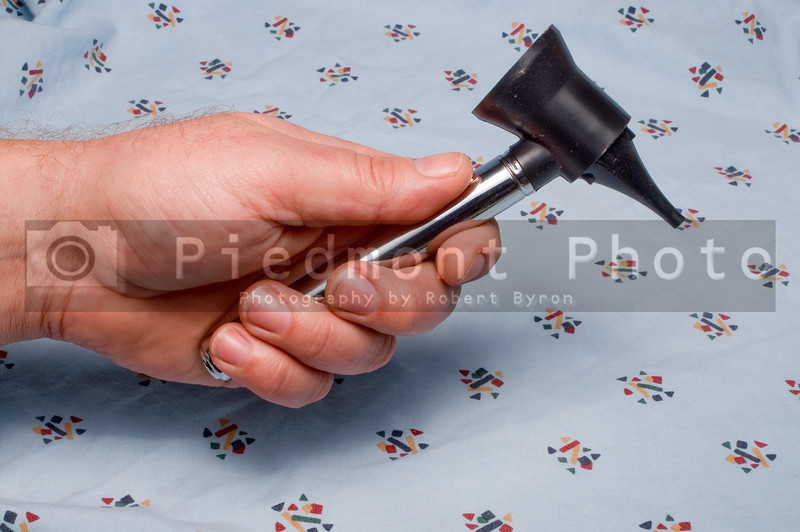A medical otoscope or opthalmascope used for checking ears noses and throats.