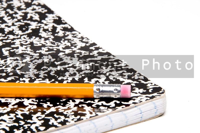 A number 2 pencil and a composition book.