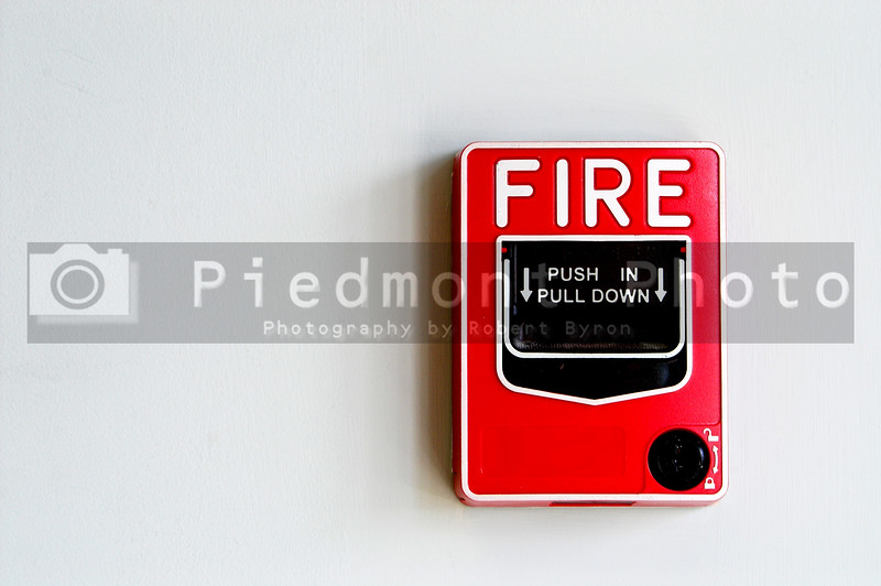 A Fire Alarm Pull Box installed on a wall.