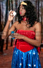 An African American woman dressed in a Halloween costume blowing bubbles