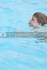 A little boy swimming in a pool.