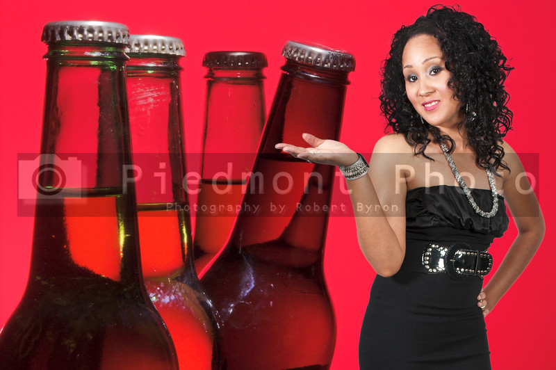 An beautiful black woman with the adult beverage known as beer