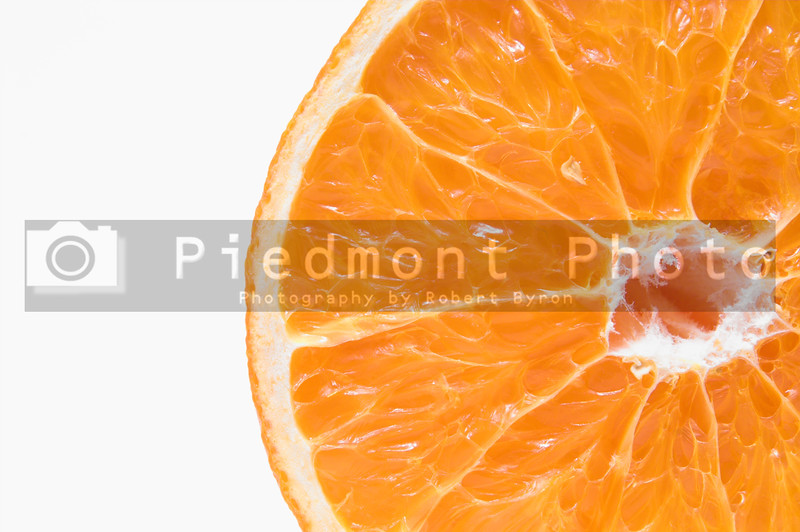 A cross section of a fresh and juicy orange.
