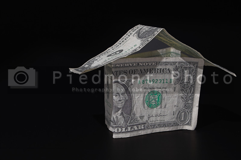 A house made out of one dollar bills - Realty / Investment Concept