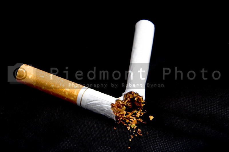 A broken nicotine laden tobacco cigarette.